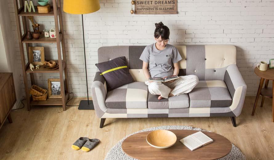 Girl sitting crossed leg on Continental Sofa